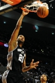 Nov 2, 2013; Portland, OR, USA; San Antonio Spurs power forward Tim Duncan (21) dunks the ball during the third quarter of the game against the Portland Trail Blazers at the Moda Center. The Blazers won the game 115-105. Mandatory Credit: Steve Dykes-USA TODAY Sports