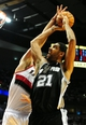 Nov 2, 2013; Portland, OR, USA; Portland Trail Blazers center Robin Lopez (42) blocks the shot of San Antonio Spurs power forward Tim Duncan (21) during the third quarter of the game at  the Moda Center. The Blazers won the game 115-105. Mandatory Credit: Steve Dykes-USA TODAY Sports