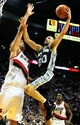 Nov 2, 2013; Portland, OR, USA; San Antonio Spurs shooting guard Manu Ginobili (20) drives to the basket on Portland Trail Blazers center Robin Lopez (42) during the fourth quarter of the game at  the Moda Center. The Blazers won the game 115-105. Mandatory Credit: Steve Dykes-USA TODAY Sports