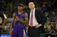 Nov 2, 2013; Oakland, CA, USA; Sacramento Kings point guard Isaiah Thomas (22) speaks with head coach Michael Malone during a free throw by the Golden State Warriors during the fourth quarter at Oracle Arena. The Golden State Warriors defeated the Sacramento Kings 98-87. Mandatory Credit: Kelley L Cox-USA TODAY Sports