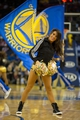Nov 2, 2013; Oakland, CA, USA; Golden State Warriors dancer performs during a timeout against the Sacramento Kings during the fourth quarter at Oracle Arena. The Golden State Warriors defeated the Sacramento Kings 98-87. Mandatory Credit: Kelley L Cox-USA TODAY Sports