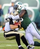 Nov 3, 2013; East Rutherford, NJ, USA; New Orleans Saints quarterback Drew Brees (left) is sacked by New York Jets defensive end Muhammad Wilkerson (96) in the second half during the game at MetLife Stadium. Mandatory Credit: Robert Deutsch-USA TODAY Sports
