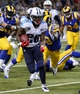 Nov 3, 2013; St. Louis, MO, USA; Tennessee Titans running back Chris Johnson (28) rushes for a touchdown against the St. Louis Rams during the second half at the Edward Jones Dome. The Titans defeated the Rams 28-21. Mandatory Credit: Scott Rovak-USA TODAY Sports