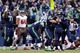 Nov 3, 2013; Seattle, WA, USA; Seattle Seahawks kicker Steven Hauschka (4) is embraced by holder Jon Ryan (9, right), tight end Zach Miller (86) and long snapper Clint Gresham (49) after making a game-winning 27-yard field goal against the Tampa Bay Buccaneers during overtime at CenturyLink Field. Seattle defeated Tampa Bay, 27-24. Mandatory Credit: Joe Nicholson-USA TODAY Sports
