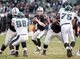 Nov 3, 2013; Oakland, CA, USA; Oakland Raiders quarterback Matthew McGloin (14) drops back for a pass against the Philadelphia Eagles during the fourth quarter at O.co Coliseum. The Philadelphia Eagles defeated the Oakland Raiders 49-20. Mandatory Credit: Ed Szczepanski-USA TODAY Sports