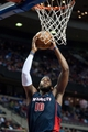 Nov 3, 2013; Auburn Hills, MI, USA; Detroit Pistons center Greg Monroe (10) slam dunks during the third quarter against the Boston Celtics at The Palace of Auburn Hills. Detroit won 87-77. Mandatory Credit: Tim Fuller-USA TODAY Sports