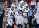 Nov 3, 2013; Houston, TX, USA; Indianapolis Colts quarterback Andrew Luck (12) celebrates with teammates after scoring a touchdown during the fourth quarter against the Houston Texans at Reliant Stadium. The Colts defeated the Texans 27-24. Mandatory Credit: Troy Taormina-USA TODAY Sports
