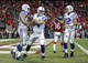 Nov 3, 2013; Houston, TX, USA; Indianapolis Colts quarterback Andrew Luck (12) and tight end Coby Fleener (80) and tight end Jack Doyle (84) celebrate after scoring on a two point conversion during the fourth quarter against the Houston Texans at Reliant Stadium. The Colts defeated the Texans 27-24. Mandatory Credit: Troy Taormina-USA TODAY Sports