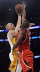 Nov 3, 2013; Los Angeles, CA, USA; Los Angeles Lakers shooting guard Xavier Henry (7) scores over Atlanta Hawks center Al Horford (15) during the second half at Staples Center. The Lakers held on for a 105-103 win. Mandatory Credit: Robert Hanashiro-USA TODAY Sports