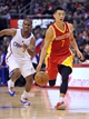 November 4, 2013; Los Angeles, CA, USA; Houston Rockets point guard Jeremy Lin (7) moves the ball ahead of Los Angeles Clippers point guard Chris Paul (3) during the first half at Staples Center. Mandatory Credit: Gary A. Vasquez-USA TODAY Sports