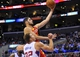 November 4, 2013; Los Angeles, CA, USA; Houston Rockets small forward Omri Casspi (18) scores a basket against the defense of Los Angeles Clippers power forward Blake Griffin (32) during the first half at Staples Center. Mandatory Credit: Gary A. Vasquez-USA TODAY Sports