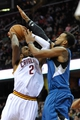 Nov 4, 2013; Cleveland, OH, USA; Minnesota Timberwolves power forward Derrick Williams (right) defends a shot by Cleveland Cavaliers point guard Kyrie Irving (2) in the fourth quarter at Quicken Loans Arena. Mandatory Credit: David Richard-USA TODAY Sports
