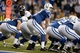Oct 20, 2013; Indianapolis, IN, USA; Indianapolis Colts quarterback Andrew Luck (12) at the line of scrimmage in the fourth quarter against the Denver Broncos at Lucas Oil Stadium. The Colts defeated the Broncos 39-33. Mandatory Credit: Ron Chenoy-USA TODAY Sports