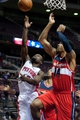 Oct 22, 2013; Auburn Hills, MI, USA; Detroit Pistons point guard Will Bynum (12) goes to the basket against Washington Wizards point guard Glen Rice Jr. (14) at The Palace of Auburn Hills. Pistons won 99-96. Mandatory Credit: Tim Fuller-USA TODAY Sports