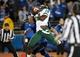 Nov 5, 2013; Buffalo, NY, USA; Ohio Bobcats quarterback JD Sprague (18) intercepts a pass in the end zone as Buffalo Bulls wide receiver Alex Neutz (19) defends during the first half at University of Buffalo Stadium. Mandatory Credit: Kevin Hoffman-USA TODAY Sports