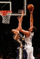 Nov 5, 2013; Brooklyn, NY, USA;  Brooklyn Nets center Brook Lopez (11) shoots over Utah Jazz center Rudy Gobert (27) during the third quarter at Barclays Center. Nets won 104-88.  Mandatory Credit: Anthony Gruppuso-USA TODAY Sports