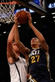 Nov 5, 2013; Brooklyn, NY, USA;   Brooklyn Nets center Brook Lopez (11) defends against Utah Jazz center Rudy Gobert (27) during the third quarter at Barclays Center. Nets won 104-88.  Mandatory Credit: Anthony Gruppuso-USA TODAY Sports