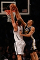 Nov 5, 2013; Brooklyn, NY, USA;  Utah Jazz center Rudy Gobert (27) fouls Brooklyn Nets center Brook Lopez (11) during the third quarter at Barclays Center. Nets won 104-88.  Mandatory Credit: Anthony Gruppuso-USA TODAY Sports