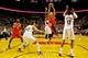 Nov 5, 2013; Portland, OR, USA; Houston Rockets point guard Jeremy Lin (7) shoots over Portland Trail Blazers center Robin Lopez (42) and power forward LaMarcus Aldridge (12) at the Moda Center. Mandatory Credit: Craig Mitchelldyer-USA TODAY Sports