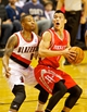 Nov 5, 2013; Portland, OR, USA; Houston Rockets point guard Jeremy Lin (7) drives to the basket past Portland Trail Blazers point guard Damian Lillard (0) at the Moda Center. Mandatory Credit: Craig Mitchelldyer-USA TODAY Sports