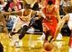 Nov 5, 2013; Portland, OR, USA; Portland Trail Blazers point guard Damian Lillard (0) and Houston Rockets point guard Jeremy Lin (7) dive for a loose ball at the Moda Center. Mandatory Credit: Craig Mitchelldyer-USA TODAY Sports