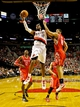 Nov 5, 2013; Portland, OR, USA; Portland Trail Blazers power forward LaMarcus Aldridge (12) shoots over Houston Rockets small forward Omri Casspi (18) at the Moda Center. Mandatory Credit: Craig Mitchelldyer-USA TODAY Sports