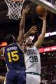 Nov 6, 2013; Boston, MA, USA; Boston Celtics center Vitor Faverani (38) shoots against Utah Jazz power forward Derrick Favors (15) in the first quarter at TD Garden. Mandatory Credit: David Butler II-USA TODAY Sports