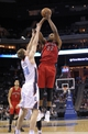 Nov 6, 2013; Charlotte, NC, USA; Toronto Raptors forward Rudy Gay (22) takes a shot as he is defended by Charlotte Bobcats forward Cody Zeller (40) during the game at Time Warner Cable Arena. Mandatory Credit: Sam Sharpe-USA TODAY Sports