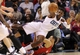 Nov 6, 2013; Charlotte, NC, USA; Charlotte Bobcats forward Jeff Adrien (4) passes the ball as he stumbles and falls during the game against the Toronto Raptors at Time Warner Cable Arena. Mandatory Credit: Sam Sharpe-USA TODAY Sports