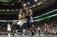 Nov 6, 2013; Boston, MA, USA; Boston Celtics power forward Jared Sullinger (7) looks for an opening past Utah Jazz power forward Derrick Favors (15) in the first quarter at TD Garden. Mandatory Credit: David Butler II-USA TODAY Sports