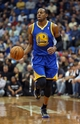Nov 6, 2013; Minneapolis, MN, USA; Golden State Warriors shooting guard Andre Iguodala (9) dribbles the ball down the court in the first half against the Minnesota Timberwolves at Target Center. Mandatory Credit: Jesse Johnson-USA TODAY Sports