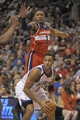 Nov 6, 2013; Philadelphia, PA, USA; Philadelphia 76ers small forward Evan Turner (12) is defended by Washington Wizards shooting guard Bradley Beal (3) during the second half at Wells Fargo Center. The Wizards defeated the 76ers, 116-102. Mandatory Credit: Eric Hartline-USA TODAY Sports
