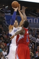 Nov 6, 2013; Orlando, FL, USA; Orlando Magic center Nikola Vucevic (9) shoots over Los Angeles Clippers center DeAndre Jordan (6) during the second half at Amway Center. Orlando Magic defeated the Los Angeles Clippers 98-90. Mandatory Credit: Kim Klement-USA TODAY Sports