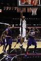 Nov 6, 2013; San Antonio, TX, USA; San Antonio Spurs forward Boris Diaw (33) drives to the basket as Phoenix Suns guard Dionte Christmas (25) and forward Marcus Morris (15) look on during the second half at AT&T Center. The Spurs won 99-96. Mandatory Credit: Soobum Im-USA TODAY Sports