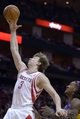 Nov 7, 2013; Houston, TX, USA; Houston Rockets center Omer Asik (3) grabs a rebound against Los Angeles Lakers center Jordan Hill (27) during the second half at Toyota Center. The Lakers won 99-98. Mandatory Credit: Thomas Campbell-USA TODAY Sports