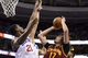 Nov 8, 2013; Philadelphia, PA, USA; Cleveland Cavaliers center Anderson Varejao (17) shoots under pressure from Philadelphia 76ers forward Thaddeus Young (21) during the fourth quarter at Wells Fargo Center. The Sixers defeated the Cavaliers 94-79. Mandatory Credit: Howard Smith-USA TODAY Sports