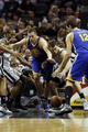 Nov 8, 2013; San Antonio, TX, USA; Golden State Warriors forward David Lee (left) fights for a loose ball with San Antonio Spurs forward Tiago Splitter (right) during the first half at AT&T Center. Mandatory Credit: Soobum Im-USA TODAY Sports