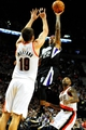Nov 8, 2013; Portland, OR, USA; Sacramento Kings point guard Isaiah Thomas (22) shoots over Portland Trail Blazers center Joel Freeland (19) during the first quarter of the game at the Moda Center. Mandatory Credit: Steve Dykes-USA TODAY Sports