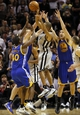 Nov 8, 2013; San Antonio, TX, USA; San Antonio Spurs guard Tony Parker (9) passes the ball over Golden State Warriors forward Harrison Barnes (40) during the second half at AT&T Center. The Spurs won 76-74. Mandatory Credit: Soobum Im-USA TODAY Sports