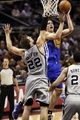 Nov 8, 2013; San Antonio, TX, USA; Golden State Warriors forward David Lee (10) puts up a shot against San Antonio Spurs forward Tiago Splitter (22) during the second half at AT&T Center. The Spurs won 76-74. Mandatory Credit: Soobum Im-USA TODAY Sports