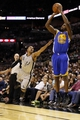 Nov 8, 2013; San Antonio, TX, USA; Golden State Warriors guard Toney Douglas (0) shoots against San Antonio Spurs guard Patrick Mills (8) during the second half at AT&T Center. The Spurs won 76-74. Mandatory Credit: Soobum Im-USA TODAY Sports