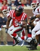 Nov 9, 2013; Oxford, MS, USA; Mississippi Rebels running back I'Tavius Mathers (5) advances the ball during the game against the Arkansas Razorbacks at Vaught-Hemingway Stadium. Mandatory Credit: Spruce Derden-USA TODAY Sports
