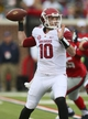 Nov 9, 2013; Oxford, MS, USA; Arkansas Razorbacks quarterback Brandon Allen (10) passes the ball during the game against the Mississippi Rebels at Vaught-Hemingway Stadium. Mandatory Credit: Spruce Derden-USA TODAY Sports