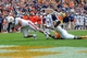 Nov 9, 2013; Knoxville, TN, USA;  Auburn Tigers running back Tre Mason (21) dives  for a touchdown against Tennessee Volunteers defensive back LaDarrell McNeil (33) during the third quarter at Neyland Stadium. Mandatory Credit: Randy Sartin-USA TODAY Sports
