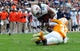 Nov 9, 2013; Knoxville, TN, USA;  Auburn Tigers running back Tre Mason (21) runs for a touchdown against Tennessee Volunteers defensive back LaDarrell McNeil (33) during the third quarter at Neyland Stadium. Mandatory Credit: Randy Sartin-USA TODAY Sports