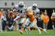 Nov 9, 2013; Knoxville, TN, USA; Auburn Tigers running back Cameron Artis-Payne (44) runs the ball against Tennessee Volunteers defensive back Max Arnold (46) during the second half at Neyland Stadium. Auburn won 55 to 23. Mandatory Credit: Randy Sartin-USA TODAY Sports