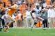 Nov 9, 2013; Knoxville, TN, USA; Auburn Tigers quarterback Nick Marshall (14) runs the ball against the Tennessee Volunteers during the second half at Neyland Stadium. Auburn won 55 to 23. Mandatory Credit: Randy Sartin-USA TODAY Sports