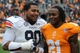 Nov 9, 2013; Knoxville, TN, USA; Auburn Tigers defensive lineman Gabe Wright (90) talks with Tennessee Volunteers defensive back Riyahd Jones (21) after the game at Neyland Stadium. Auburn won 55 to 23. Mandatory Credit: Randy Sartin-USA TODAY Sports