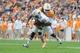 Nov 9, 2013; Knoxville, TN, USA; Tennessee Volunteers linebacker A.J. Johnson (45) tackles Auburn Tigers quarterback Nick Marshall (14) during the second half at Neyland Stadium. Auburn won 55 to 23. Mandatory Credit: Randy Sartin-USA TODAY Sports
