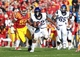 Nov 9, 2013; Ames, IA, USA; Texas Christian Horned Frogs running back Aaron Green (22) is chased by Iowa State Cyclones Willie Scott (50) at Jack Trice Stadium.  Texas Christian beat Iowa State 21-17.  Mandatory Credit: Reese Strickland-USA TODAY Sports